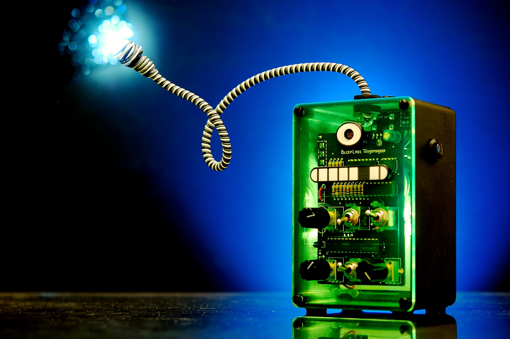 Image showing a small green electronic device, which powers a small light