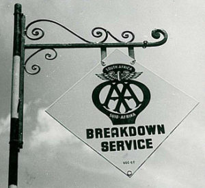 """A black and white image of a sign that reads """" AA South Africa Breakdown Service"""""""