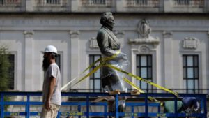 an image of former president of the confederate states of america jefferson davis ensnared in moving harnesses