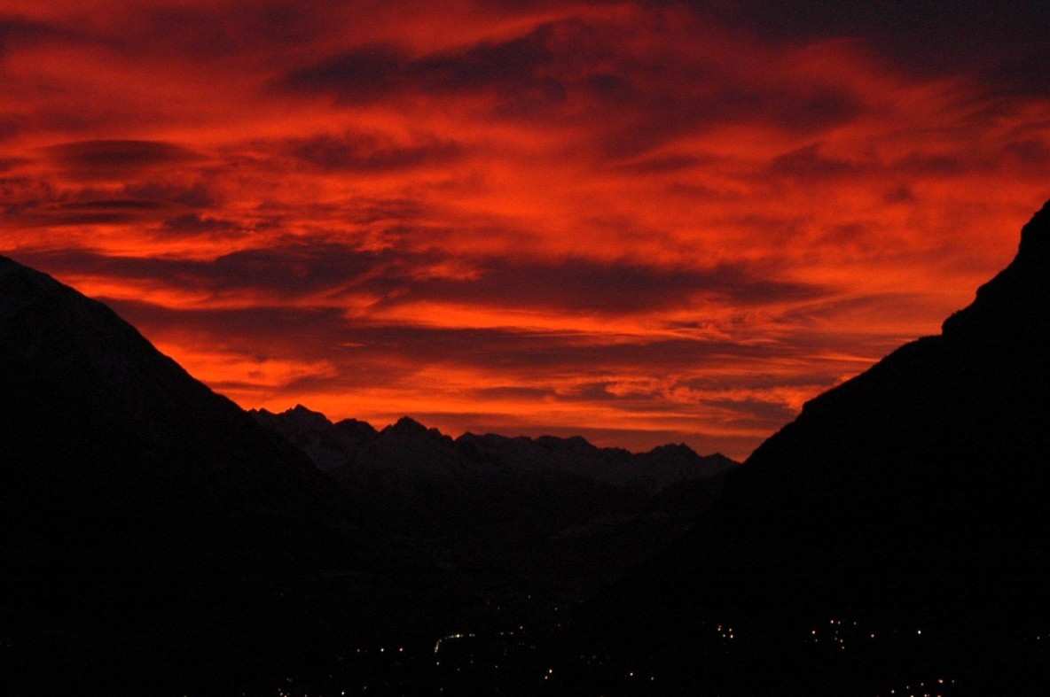 A red sky over a valley.