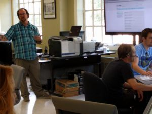 Will Burdette, Lab Coordinator, leads the workshop on audio recording, in Parlin Hall 102.