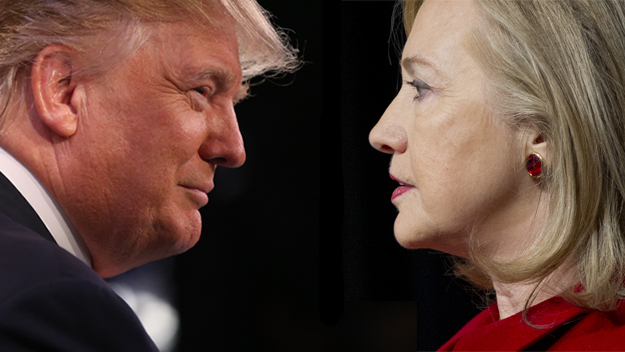 A close-up picture of Donald Trump on the left and Hillary Clinton on the right. On the picture, it seems as if they look at each other from a very close distance. Donald Trump has blond hair and seems to wair a suite, of which one can only see the dark texture on his shoulder and the white collar. Hillary Clinton has blond hair, wears red ear rings, and a red blouse or costume of which one can only see to the shoulder area.