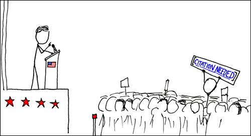 A cartoon stick-figure of someone giving a speech. In the middle of the crowd, one person's head is visible, and this stick figure is holding up a sign that reads citation needed.