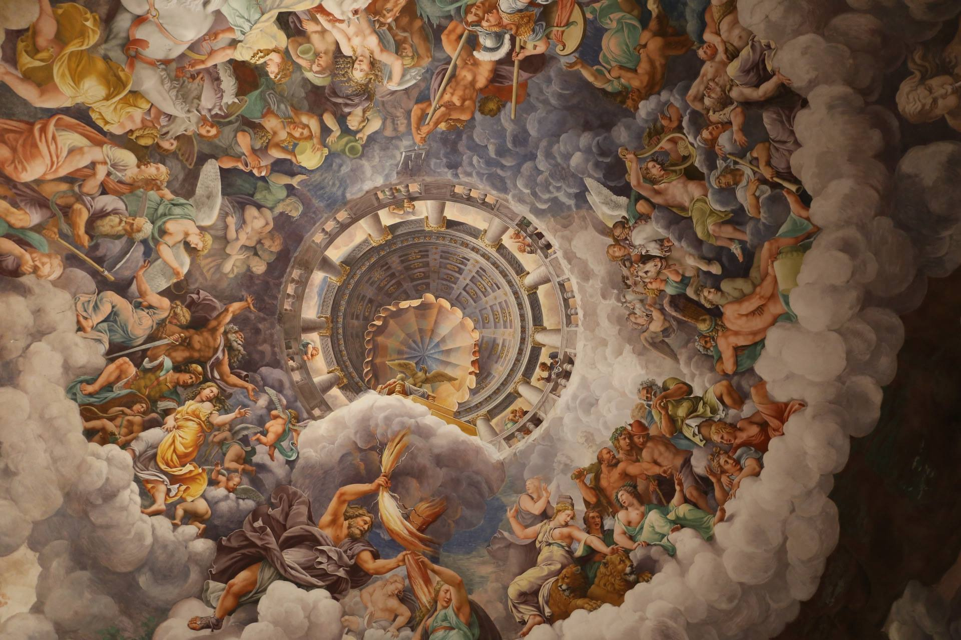 Photo of the domed ceiling of the Palazzo del Te in Italy, painted to tell the Greek legend of the giants' removal from Olympus.