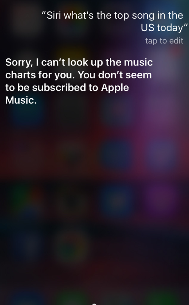 """Screen shot of an iPhone engaging Siri. User asks: """" Siri, what are the top songs in the US?"""" Siri responds: """"Sorry, I can't look up the music charts for you, you don't seem to be subscribed to Apple Music. This image shows the intersection between Company propaganda and Artificial Intelligence personality."""