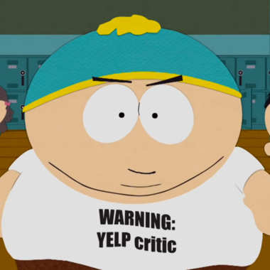 Eric Cartman from the cartoon show South Park wearing a t-shirt that reads Warning Yelp Critic.