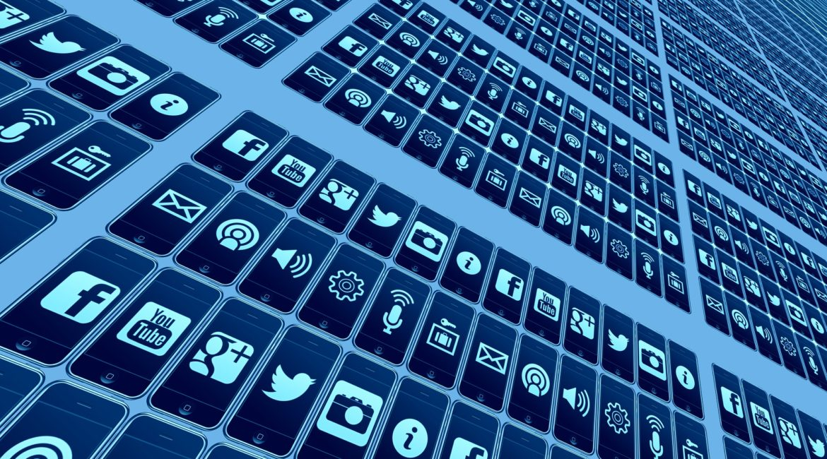 Diagonal matrix with rows and columns of mobile phones with different social media icons like Facebook, YouTube, and Twitter.