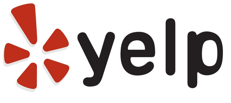 This is the logo of Yelp, followed by the four lower case letters in black: yelp. The background is white. The logo is red.
