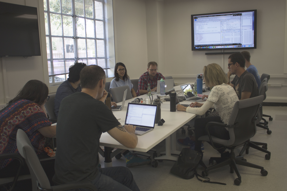 Lars Hinrichs, pictured center, leads the workshoppers through an intro to the language of R.