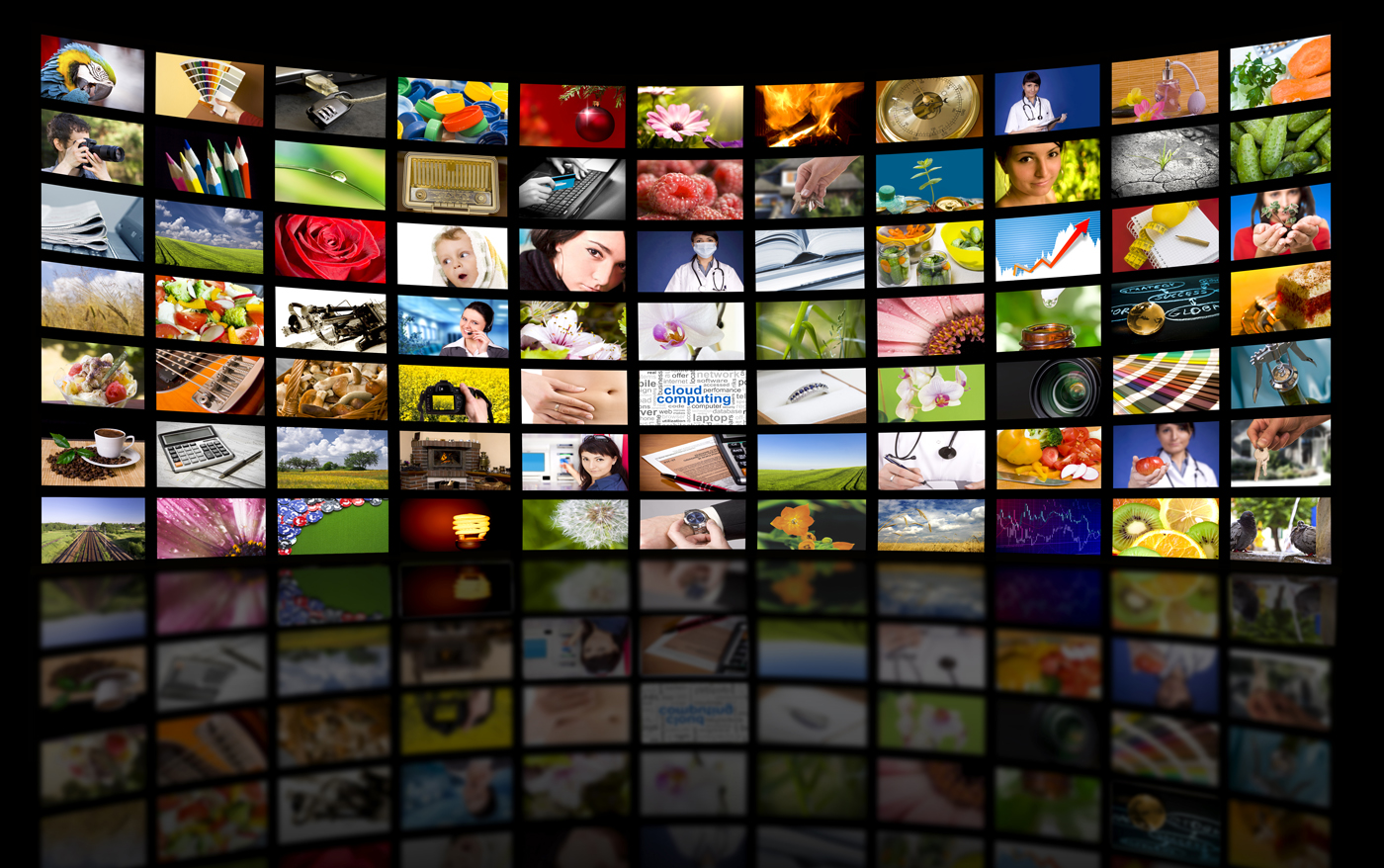 This image shows a great number of different screens before a black background. It expresses a great variety of video technologies.