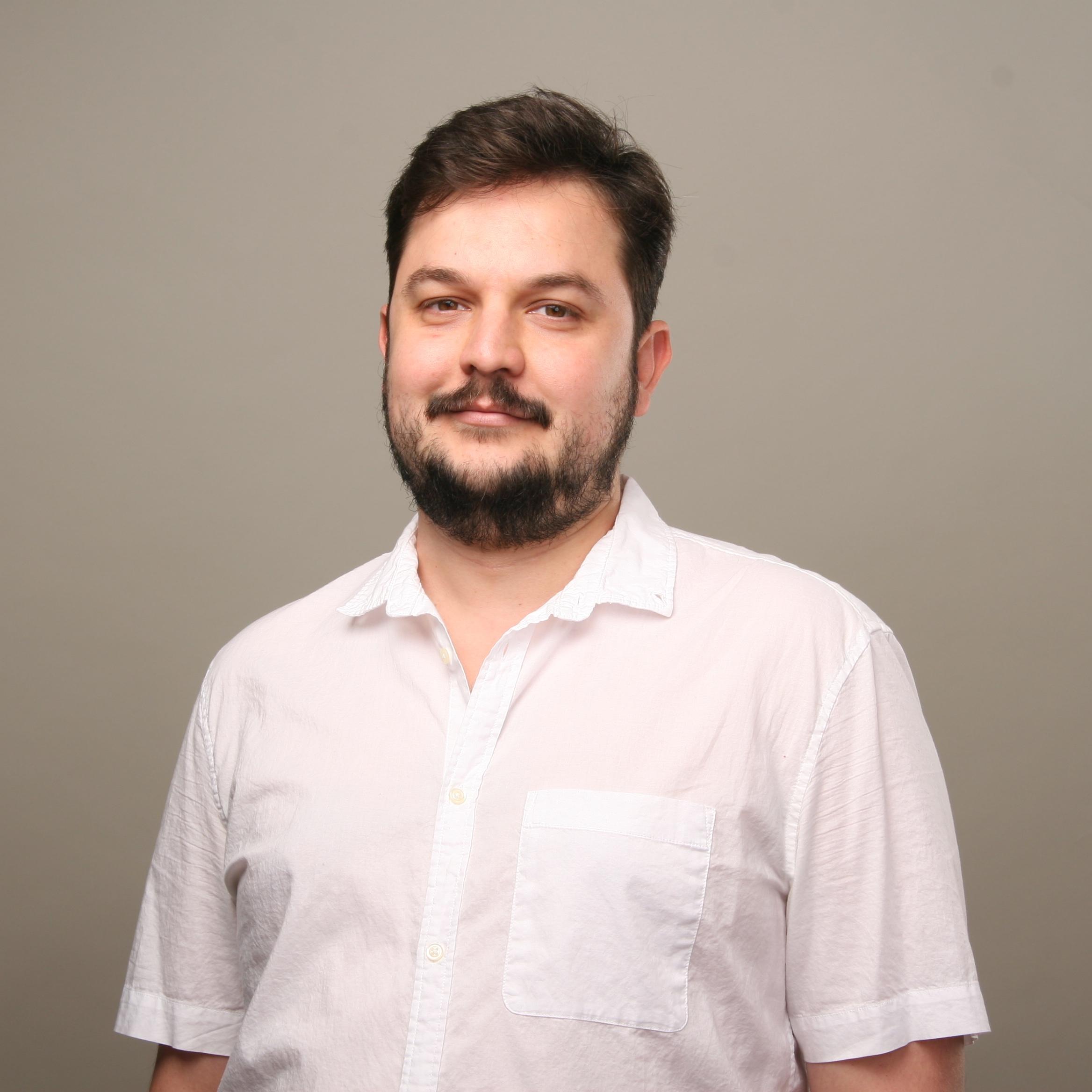 Headshot of DWRL Staffer Claudio Eduardo
