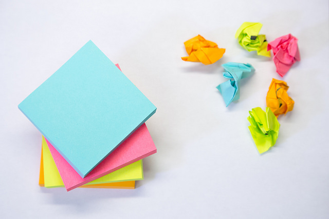 Stacks of post-it notes next to crumpled post-its