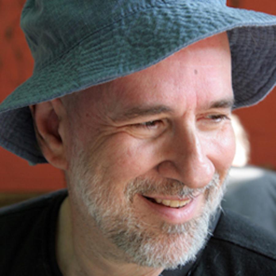 Photo of John Slatin in a blue hat